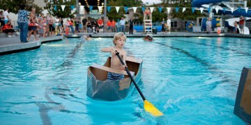 Contestant crossing the pool during the Build Your Own Boat Regatta