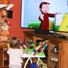 My daughter watching Curious George on television